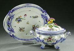 A FRENCH FAIENCE SOUP TUREEN AND STAND, 20th century. Mushroom finial, rocaille and floral decoration - 18 in. long.