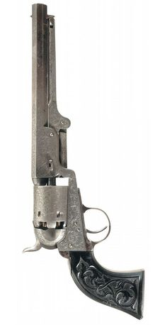 Engraved Colt Model 1851 with carved ebony grips. Mid 19th century.