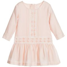 Baby girls pink long-sleeved Chloé dress with delicate ivory lace embroidered inserts and pleated detail. Made in a lightweight twill with a soft blend of viscose and wool. Lined in soft cotton, it has a concealed zip at the back to fasten and an embroidered logo to finish. A bodyvest could be worn underneath to keep baby warm on cooler days.
