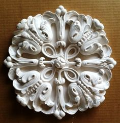 Fresh from the factory floor, this plaster medallion is headed down to Orlando to decorate a portion of a major, but unnamed, resort chain.  Made by hand, this plaster ceiling medallion features bellflowers amid a geometric tangle of vines.