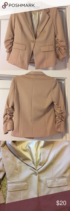 """Beige 3/4 length Ruched Sleeve One-Button Blazer Beige 3/4 length Ruched Sleeve One-Button Blazer. Size M. Two front flap pockets. 34"""" bust.  14.5"""" shoulder width. Small pull in fabric as seen in picture 3. Shell: 95% Polyester, 5% Spandex. Lining: 100% Polyester Fab'rik Jackets & Coats Blazers"""