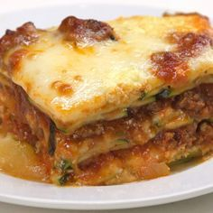 This low-carb lasagna amazes with zucchini slices instead of pasta, three kinds of bubbling cheese, seasoned ground beef, and homemade tomato basil sauce.