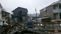 """""""My uncle's house in Breezy Point, NY. Knocked off foundation and tilting. Breezy Point, Hurricane Sandy, Photo S, Foundation, Nyc, House, Haus, Home, New York City"""