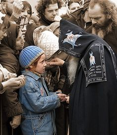 Orthodox monk and little girl