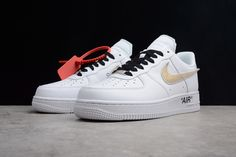 OFF-WHITE x Nike Air Force 1 Low White Black Gold AA8152-700  The OFF-WHITE x Nike Air Force 1 Low sneaker boasts a metallic Swoosh, Off-White? branding detailing, and an AIR motif in double quotation marks on the lateral midesole.  Tags: Nike Air Force 1, Off-White Shoes, Off-White, Off-White Air Force 1 Model: OFFWHITE-AA8152-700 5 Units in Stock Manufactured by: OFF-WHITE White Air Force 1, Off White Shoes, Black Gold Jewelry, White Brand, New York Fashion, Nike Air Force, Winter Outfits, Sneakers Nike, Quotation Marks