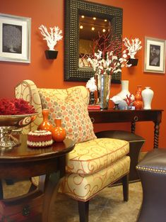 This wall color (Sherwin-Williams Knockout Orange) reminds me of terra cotta and makes the traditional furniture look rich and handsome. I also like how the crisp white accessories were used to add pops of light. ~s