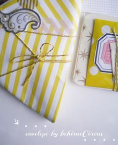 yellow envelope by BohèmeCircus - stripes like a circus tent - via Flickr.