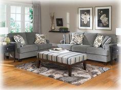 Grey is the new beige! This contemporary #sofa and #loveseat from Ashley Furniture HomeStore works well with neutrals and bright colors.