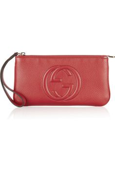 Red textured-leather (Calf) Wristlet strap Stitched 'GG', gold hardware Internal zipped pocket and six card slots Fully lined in canvas Zip fastening along top