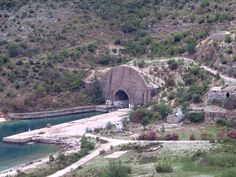 This tunnel at the north end of Porto Palermo Bay, Albania, was used to shelter fast coastal defence vessels during the Communist era. It's still a forbidden military zone. Albania, Palermo, Shelter, Coastal, Military, Porto, Army, Military Man