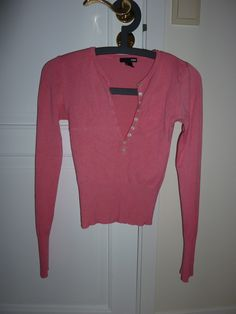 H pink sweater