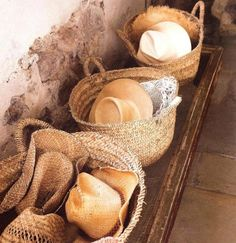 .Woven Straw Baskets Full Of Woven Straw Hats. What else do you need?