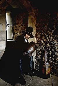 On this day 5th November, 1605, Guy Fawkes was arrested when around 30 barrels of gunpowder, camouflaged with coal, were discovered in the cellar under Parliament, Robert Catesby's small band of Catholic Zealots who planned to blow up James I and Parliament were only arrested after Fawkes revealed their names when tortured on the rack. The 'Gunpowder Plot' is commemorated each year in Britain on 5th November, 'Guy Fawkes' night or Bonfire Night