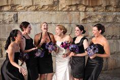 Modern mismatched black bridesmaids dresses with purple bouquets