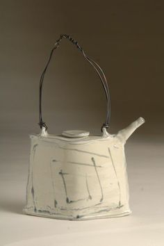 ceramic teapots with wire handles | Found on charmingspaces.tumblr.com