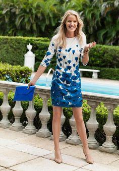 Shop this look on Lookastic: https://lookastic.com/women/looks/shift-dress-pumps-clutch-bracelet-bracelet/10584 — Black Bracelet — Gold Bracelet — White and Blue Floral Shift Dress — Blue Leather Clutch — Tan Leather Pumps