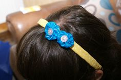 Yellow Headband with Blue Ruched Flowers and Pale Pink Buttons.