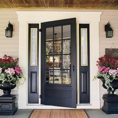 Love the planters that match the doors. Love the doors with the the panels on each side. The Doors, Entry Doors, Front Entry, Front Stoop, Door Entryway, Room Doors, Patio Doors, Sliding Doors, Home Staging