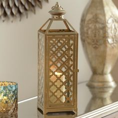 Add a touch of Grecian flair to your loved ones' homes this Christmas by gifting Kirkland's Champagne Quatrefoil Metal Lantern. It's the perfect gift for her!