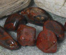 Red Jasper - very strong power stone, good for combating exhaustion and for maintaining physical stamina.  Red Jasper has a stabilizing effect on the wearer's energy keeping them calm, balanced, and focused.