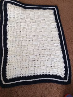 Navy and white crochet blanket