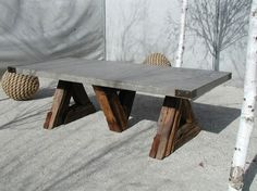 Concrete table for my new patio with rail road ties for the base. What a dream.