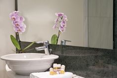 Rooms at Arion Athens Hotel feature large marble bathrooms.