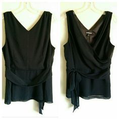 Express Sleeveless Black Faux Wrap Dress Tank sz L Has a gauzy chiffon-like overlay, lined with a satiny inner liner. Zips at side with attractive pleating. Empire waist tie (attached). Please see pics for details. This to is so beautiful on, flattering to most any shape. Great for a night out! Express Tops Tank Tops