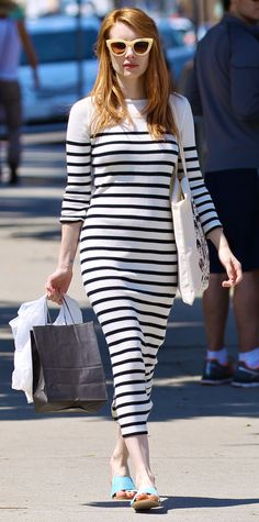 AS A DRESS Instead of a shirt, Emma Roberts did Breton stripes as a dress. She channeled '70s icons—Brigitte Bardot and Jane Birkin, specifically—with a lined knit that was equal parts chic and casual. Streamlined statement extras, like cat-eye sunglasses and minimalist slides, completed her look to perfection.  7 Stars Give Us More of a Reason to Love Nautical Stripes - As a Dress  - from InStyle.com