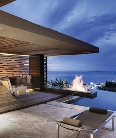 I like the linear fire pit above the pool