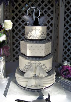 Elegant Black , White and Silver Buttercream Wedding Cake with Bling by Graceful Cake Creations, via Flickr