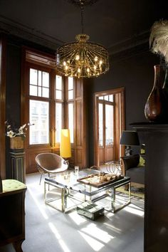 dramatic from floor to ceiling, with black walls + a golden chandelier,