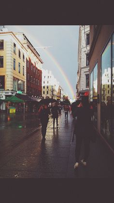 Sunshine in the rain . Oslo september . We found the rainbow, Oslo Main street Karl Johan