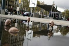 installations by isaac cordal