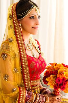 This Indian bride is a vision in her red and yellow bridal lehenga. Take a closer look at the sheer dupatta with embellishments all over. Big Fat Indian Wedding, Indian Bridal Wear, Indian Wear, Indian Weddings, Indian Style, Bridal Lehenga, Lehenga Choli, Indian Dresses, Indian Outfits