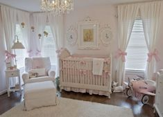 vintage white nursery... Love the bows on the panels & that adorable pink plane !!