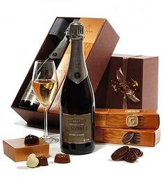 Founded over a century ago, siblings Anne and Antoine are the 4th generation to run the Lenoble Champagne house. Robert M. Parker of the Wine Advocate called Lenoble ''an exciting discovery.'' This spectacular gift includes Champagne Lenoble Brut, 0.75L Godiva Biscuits Hazelnut Praline Godiva Biscuits Raspberry Premiere Godiva Gold Ballotin 4 pcs Makes the ideal gift for thanking, congratulating, or sending joyous wishes. Components may vary slightly from country to country to ensure the…