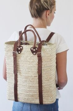 A classic straw tote with a twist. Handmade in Morocco, this straw and genuine leather strap backpack is the ideal beach bag. Whether you're riding a bike or walking with your beach gear, the backpack