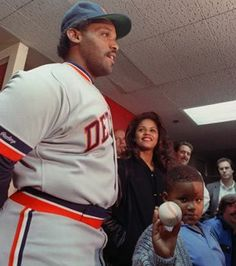 Former Detroit Tiger, Cecil Fielder with his son Detroit Tiger, Prince Fielder holding the baseball.