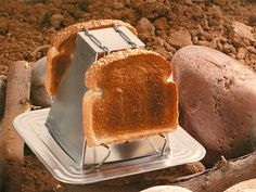 A toaster for camping? Yes, the non-electric Genuine Pyramid Toaster functions just as well over a campfire as it does your living room fireplace.