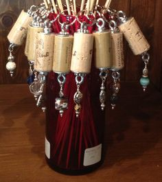 Wine cork with charms and crystals key chains.... So clever!