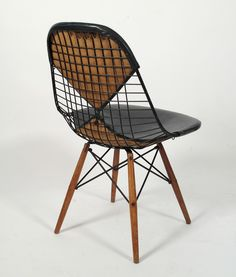 """Bikini Back"" Eames wire chair with wooden dowel legs, for Herman Miller. What's not to like?"