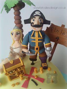 Pirate island cake with treasure, captive princess, palm tree and sugar details.