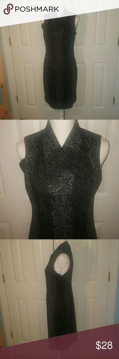 Calvin Klein black knit career dress size 10 Fun black snake print Calvin Klein knit career dress. Size 10  excellent condition!! Bundle and save. Calvin Klein Dresses Midi