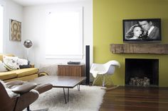 White, white, white... colorblocking... love this yellow/green fireplace.