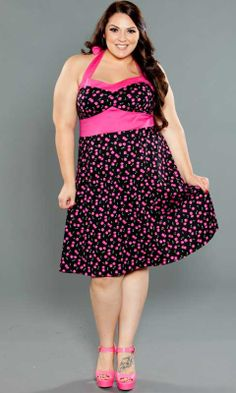 A pin up halter dress with flirty style . The Nellie Dress has a contrast waist which highlights your waistline while giving you that sexy pinup look. Available in the Curvy Kitten by SWAK Designs Collection.