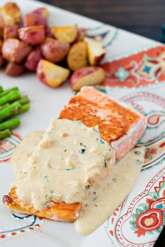 Pan-Crisped Salmon with Light Garlic Dijon Cream Sauce - Making this for tea tonight and oh man, I am already hungry.