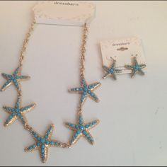 "DressBarn Gold Turquoise Starfish Necklace Set NWT New with Tags. Gold tone chain features 5 star fish (1 1/2"" each) embellished with turquoise colored beads. Necklace is adjustable between 17"" to 20"". Earrings are pierced. No problems to report with either piece. I'm also open to splitting up the set if necessary. Dress Barn Jewelry Necklaces"