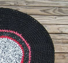 """Black White Red Crocheted Cotton Rug round 37"""" across upcycled materials hand made by me primitive folk art western country log cabin by TopDrawerThreads on Etsy"""