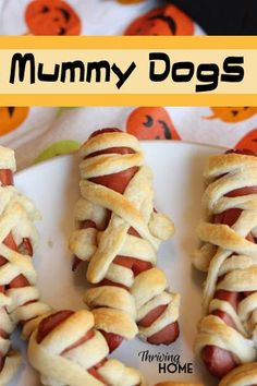 Mummy dogs are an easy to make, fun Halloween treat.  This spooky treat is a huge hit at Halloween parties. Make lots! | Thriving Home